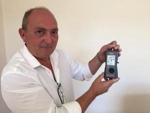Martin Kingsbury displays radiation meter