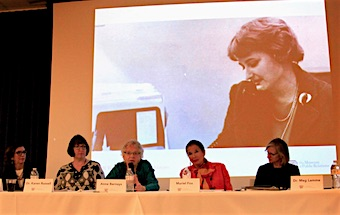 Image of Betsy Plank behind the panelists